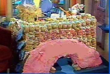 A TABLE MADE OUT OF DONCAN DONUTS FOR THE ROSIE SHOW